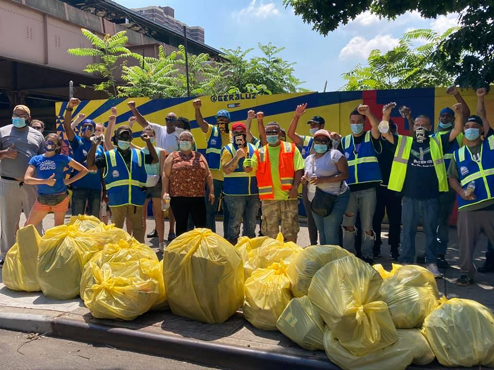 Yellow trashbags with the Positive Workforce Clean Team