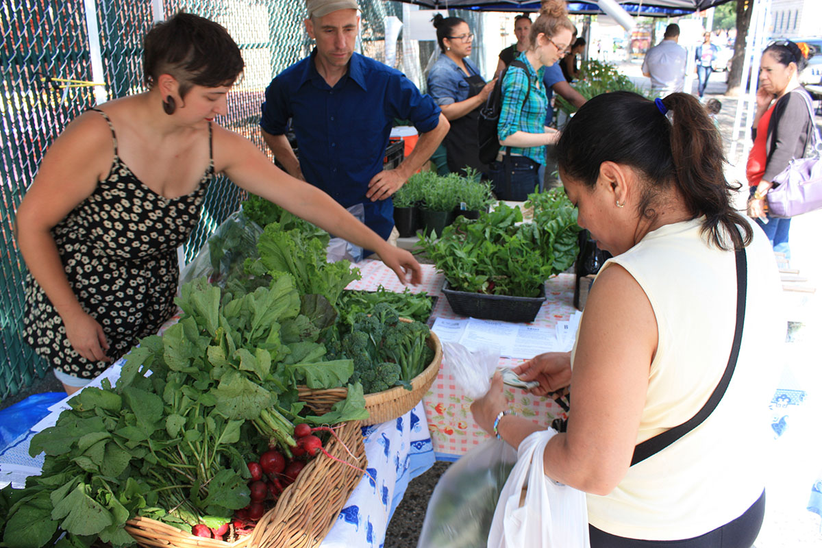 Farmers proudly sell their locally-grown produce