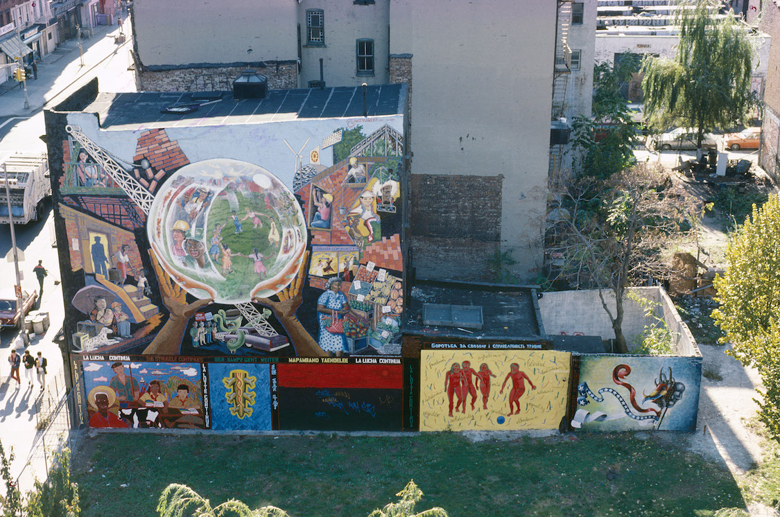 Collective mural and individual murals from La Lucha Continua The Struggle Continues, 1985, La Plaza Cultural, Loisaida. Photo: Camille Perrottet