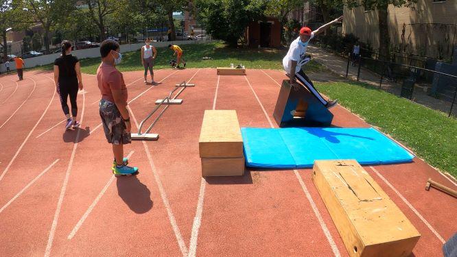 Children and Women train at a recent Bullettrun parkour class at Wingate Park.