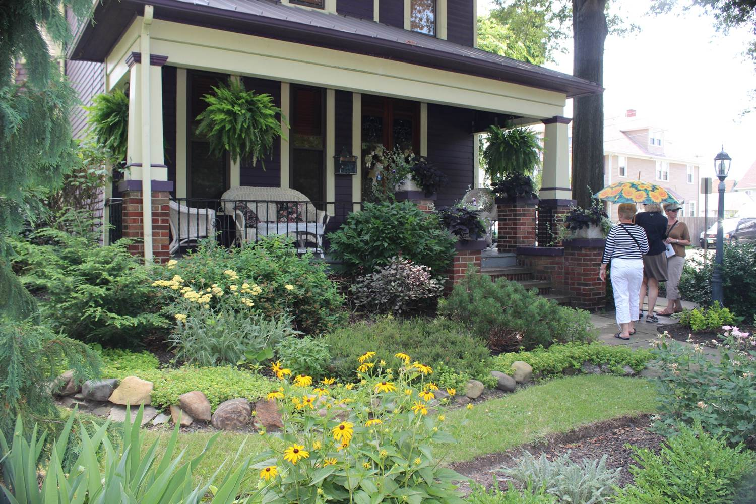 Visitors tour a garden in the city of Cleveland.