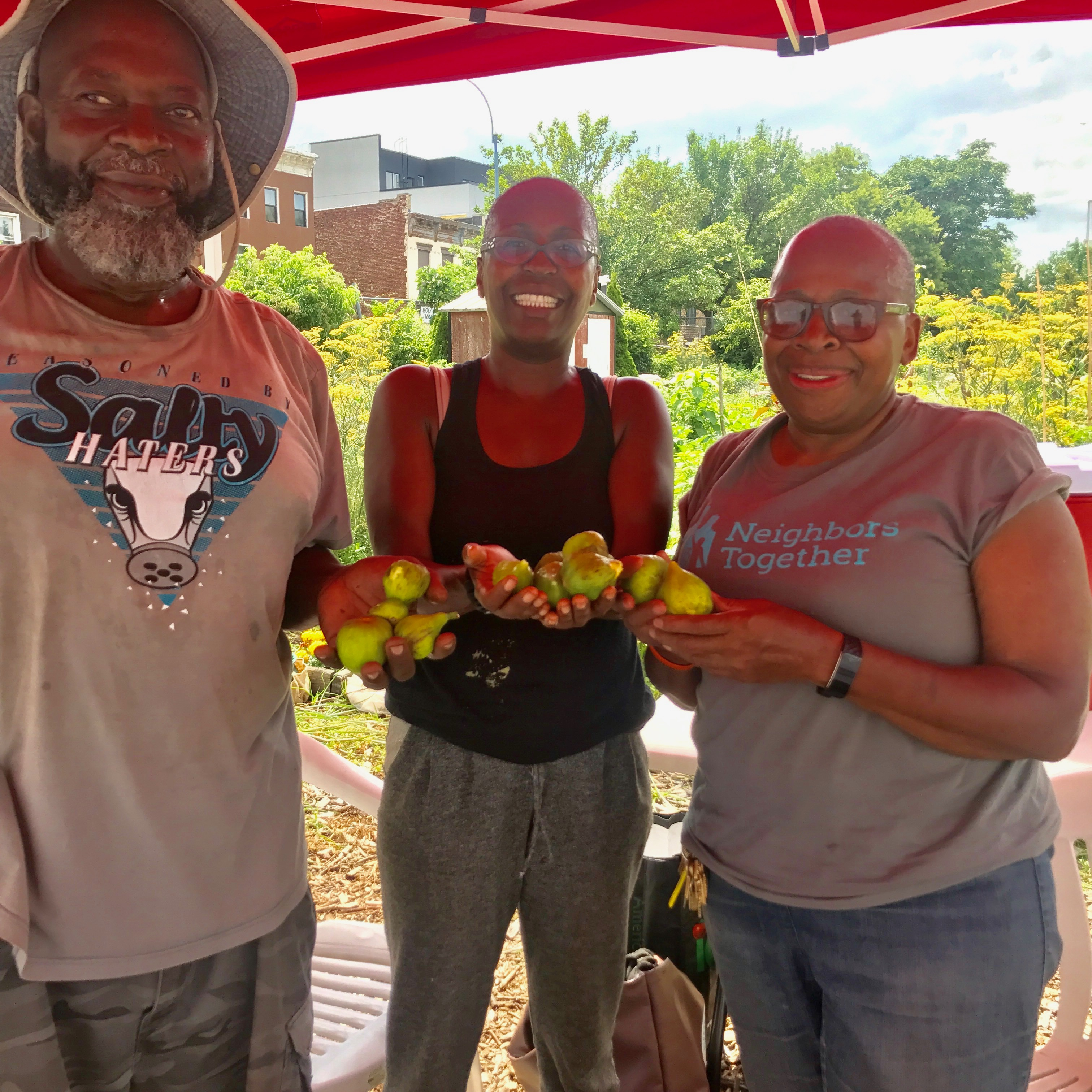 Phoenix Community Gardeners display fresh tomatoes.
