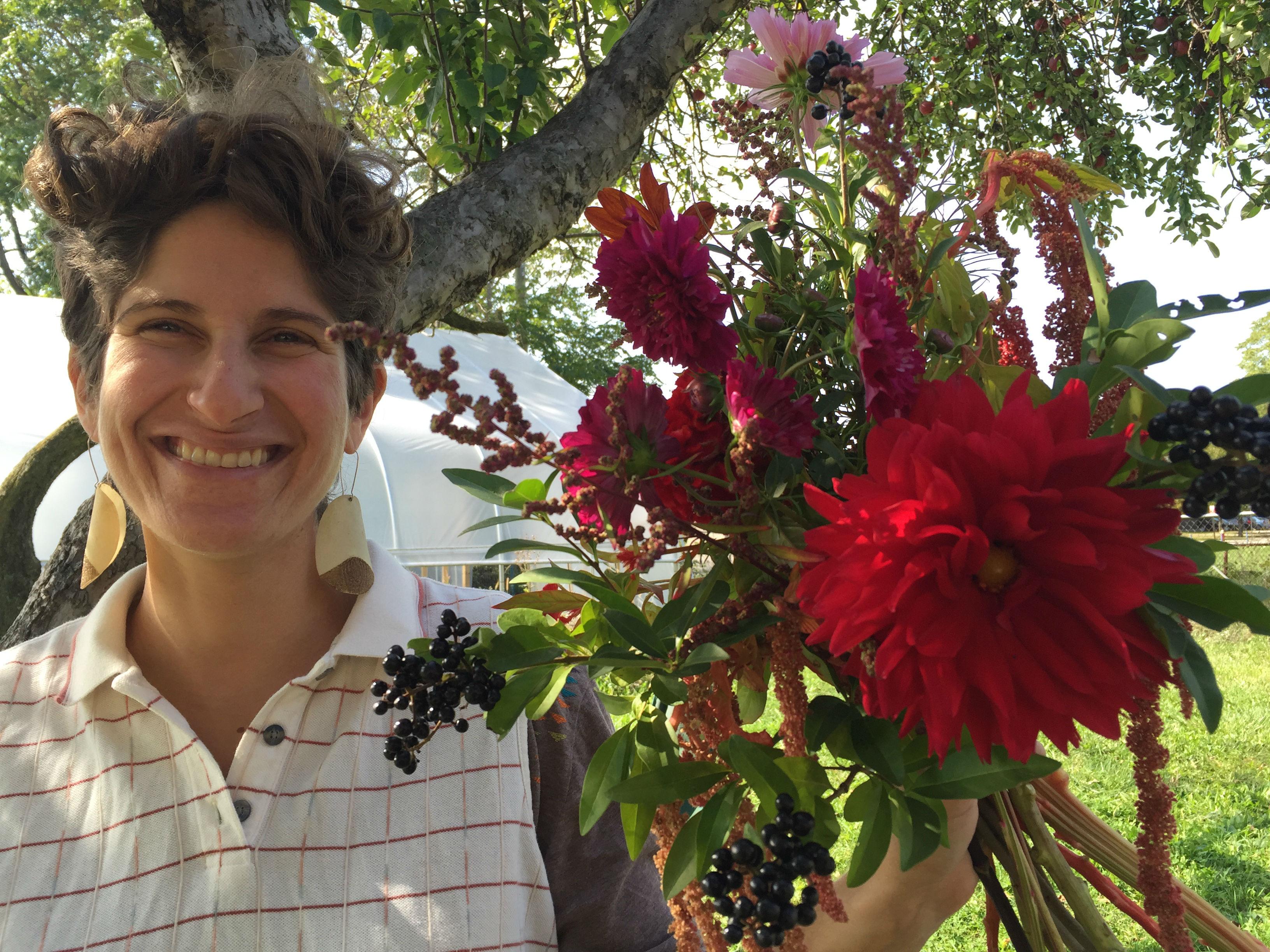 Farmer Sarah with a Fresh Cut autumn bouquet.