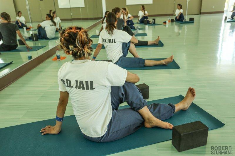 Women in prison in a yoga class