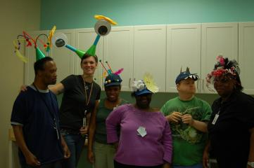 Crazy hat day: Allison with individuals from SRVS