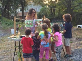 Children learn about pollinators at a Kids Gardening Workshop