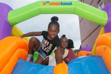 Children play in bounce house at National Night Out in Garfield