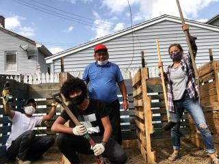 Building Compost System with New Americans