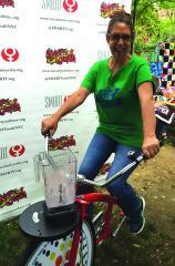 Founding Director, Susan Rodriguez riding the Fender Blender Bike.