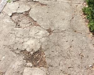 Example of sidewalk needing immediate repair.