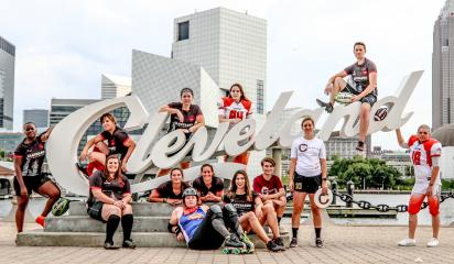 female athletes in front of cleveland sign
