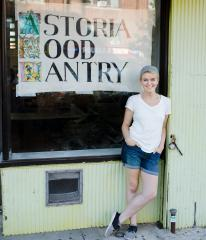 Macaela the pantry's founder standing outside our location on Steinway St.