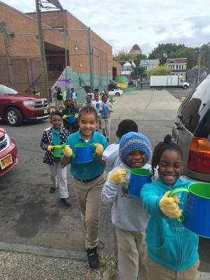 Students carry 30 watering cans down 3 stories to grow our garden.