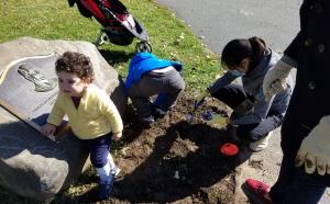 Families volunteering to beautify O'Rourke.