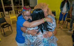 Community members hugging during mental health experience