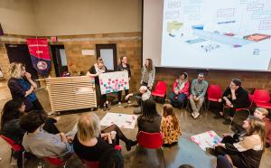 Photo of a students sitting in a circle during a workshop on community engagement