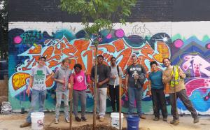 youth crew standing around a tree they just planted