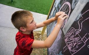 Child at Chalkboard