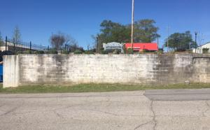 Picture of the old wall that is unsound.