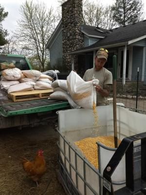 Picture of Nate mixing poultry feed