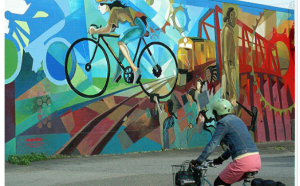 This is an example of what the mural could potentially look like. We like the cycling and trail theme along with the vibrate colors.